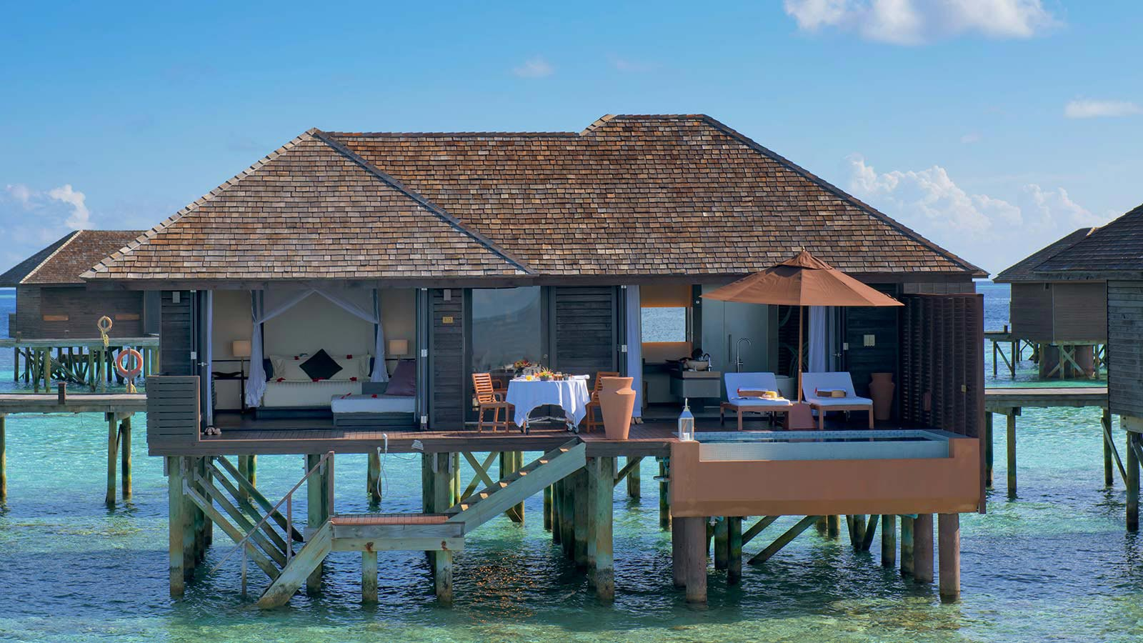 Maldives deluxe water villas maldives accommodation for Sunset lodge