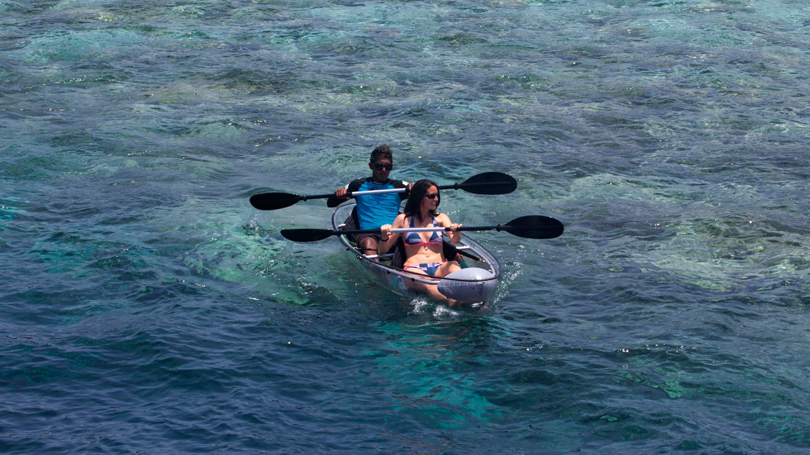 Glass Bottom Canoe at Lily Beach Maldives