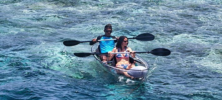 Explore the Ocean around Lily Beach on a Glass-Bottom Canoe